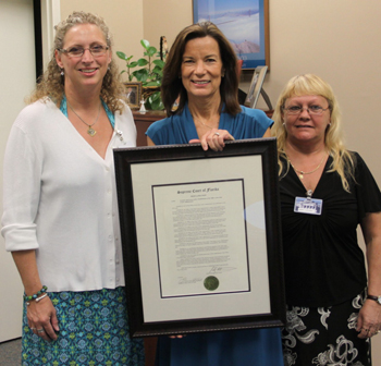 Lisa Goodner displays 40th anniversary proclamation