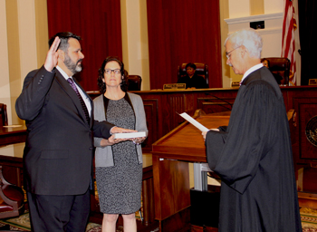 John Tomasino is sworn in as the new Clerk of the Supreme Court by Chief Justice Ricky Polston