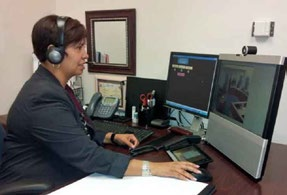 Remote interpreting systems facilitate sharing interpreting resources among different court facilities within the same circuit, or even among different circuits, thereby containing the costs of interpreting resources while maintaining accuracy. Pictured here is an interpreter in the Ninth Circuit utilizing a remote interpreting system.