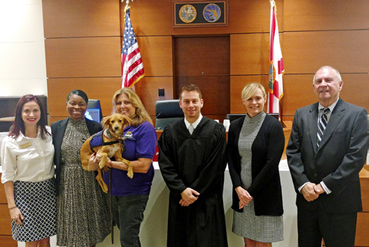 In 2017, ChiefJudge Elizabeth A. Metzger, Nineteenth Circuit visited the Seventeenth Circuit to learn about its animal therapy program.