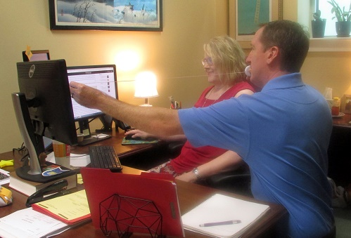 Ms Beverly Beard, paralegal with the supreme court's Central Staff, learns some tips for avoiding shoulder, arm, hand, back, and eye strain from Mr. Robert Lisson, an occupational therapist with On Site Therapy in Tallahassee.